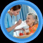 caregiver feeding patient