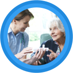 caregiver assisting patient in taking medicines