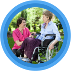 caregiver talking to patient on the wheelchair